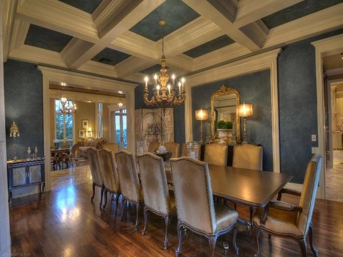 traditional dining room with box beam ceiling with crown molding
