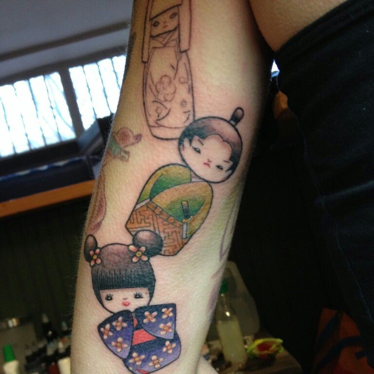 Kokeshi doll tattoo almost done. For me, lil brother and little sister. Tattoo by Mike Munter @ hunter gatherer tattoo