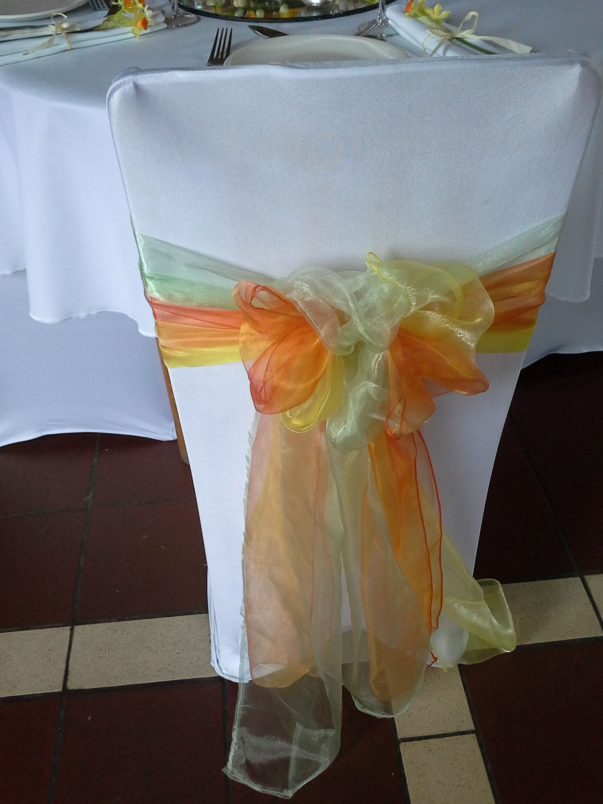 Yellow Chair Covers A White Chair Cover With Summer Green Orange And Yellow Chair