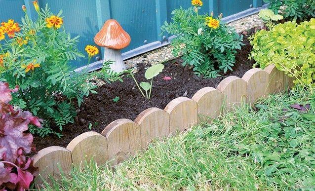 Fabriquer Une Bordure De Jardin Avec Du Bois De Palette Bordure Jardin Bois Bordure Jardin Et Jardin Palette Diy