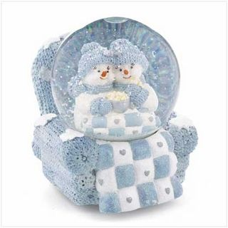 "Snow Buddies snuggle in a big, cuddly blanket, staying warm and happy in spite of the falling snow. This delightful musical snowglobe plays a medley of love songs.    Weight:3.5 lbs. 4½"" x 5"" x 5¼"" high. Resin and glass."