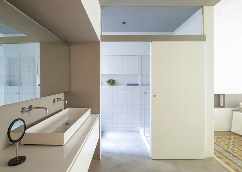 Wooden doors are paired with tiles in Nook Architects' latest home