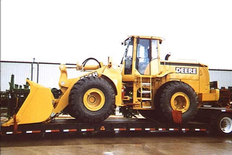 This is one of my loads when I was hauling heavy equipment.John Deere 744H which was introduced in 1997