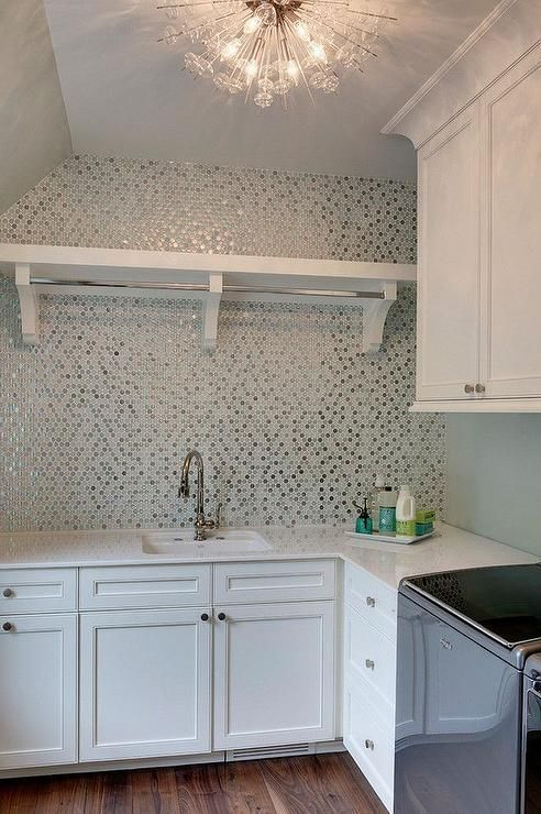 Contemporary laundry room features a a clear glass sputnik chandelier, glossy wh images