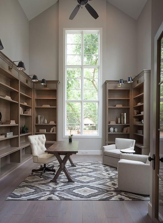 Amazing Home Office Features A Tall Vaulted Ceiling Adorned With A