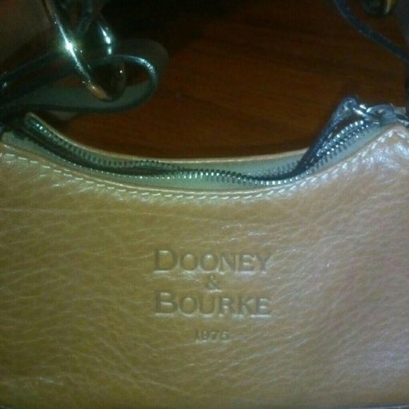 Vintage Dooney Bourke bag authentuc Nice vintage collectors bag new never used all leather adjustable straps Dooney & Bourke Bags Shoulder Bags