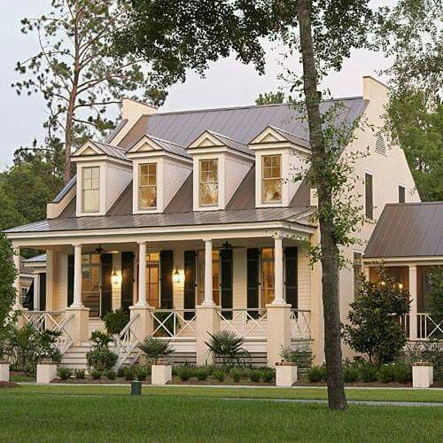 Classic Home Exterior With Dormer Windows, Black Shutters And A Pretty Porch
