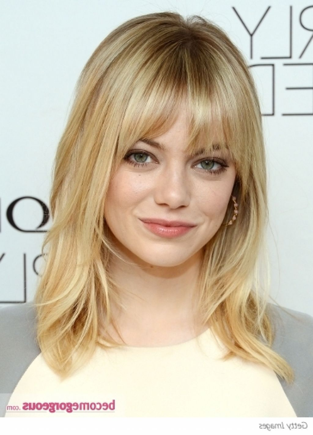 Length medium hair with lots of face framing layers and whispy bangs