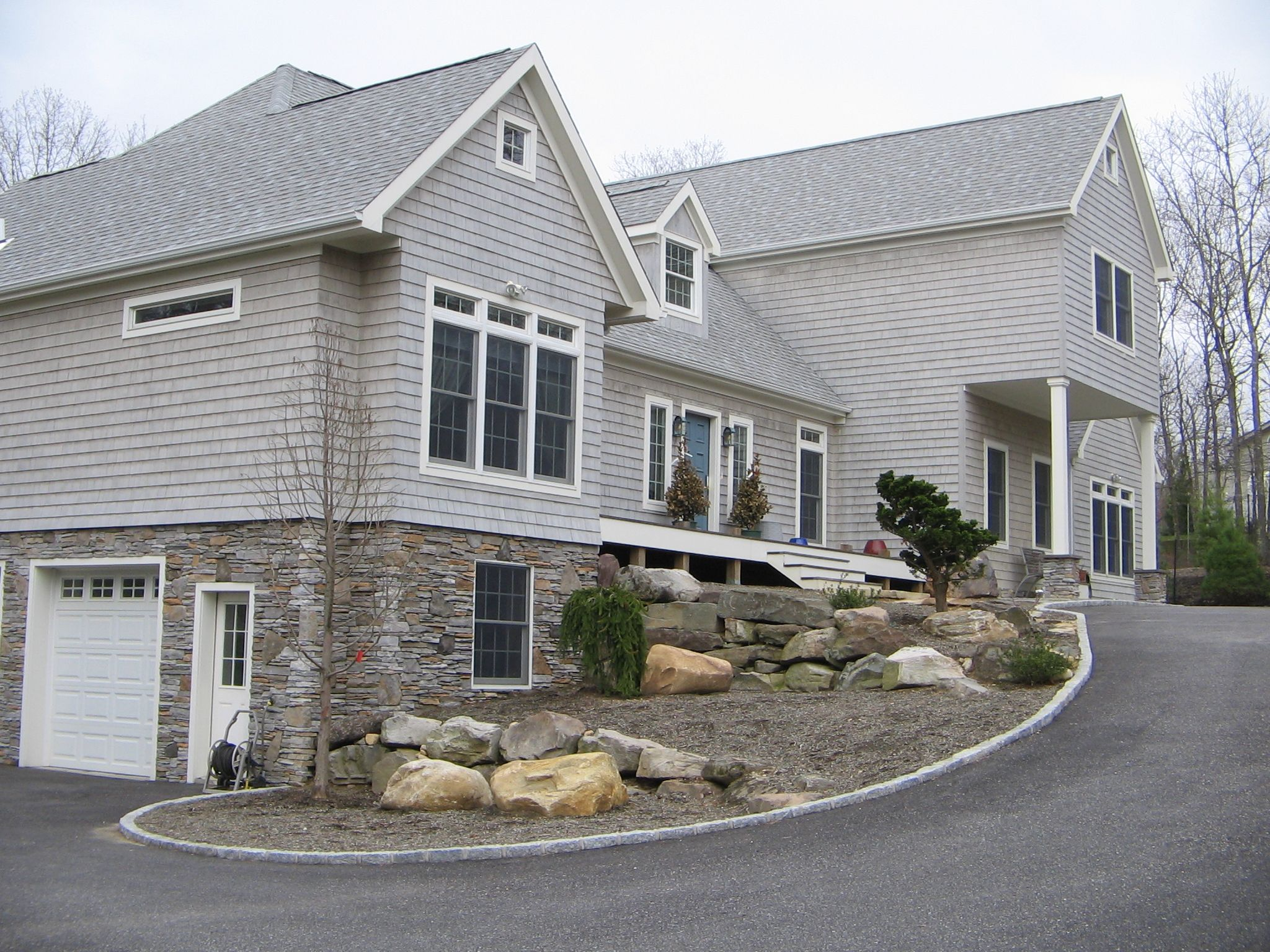 Cool custom modular two story home with drive under garage