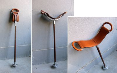 Sitting cane. Metal, wood and leather.
