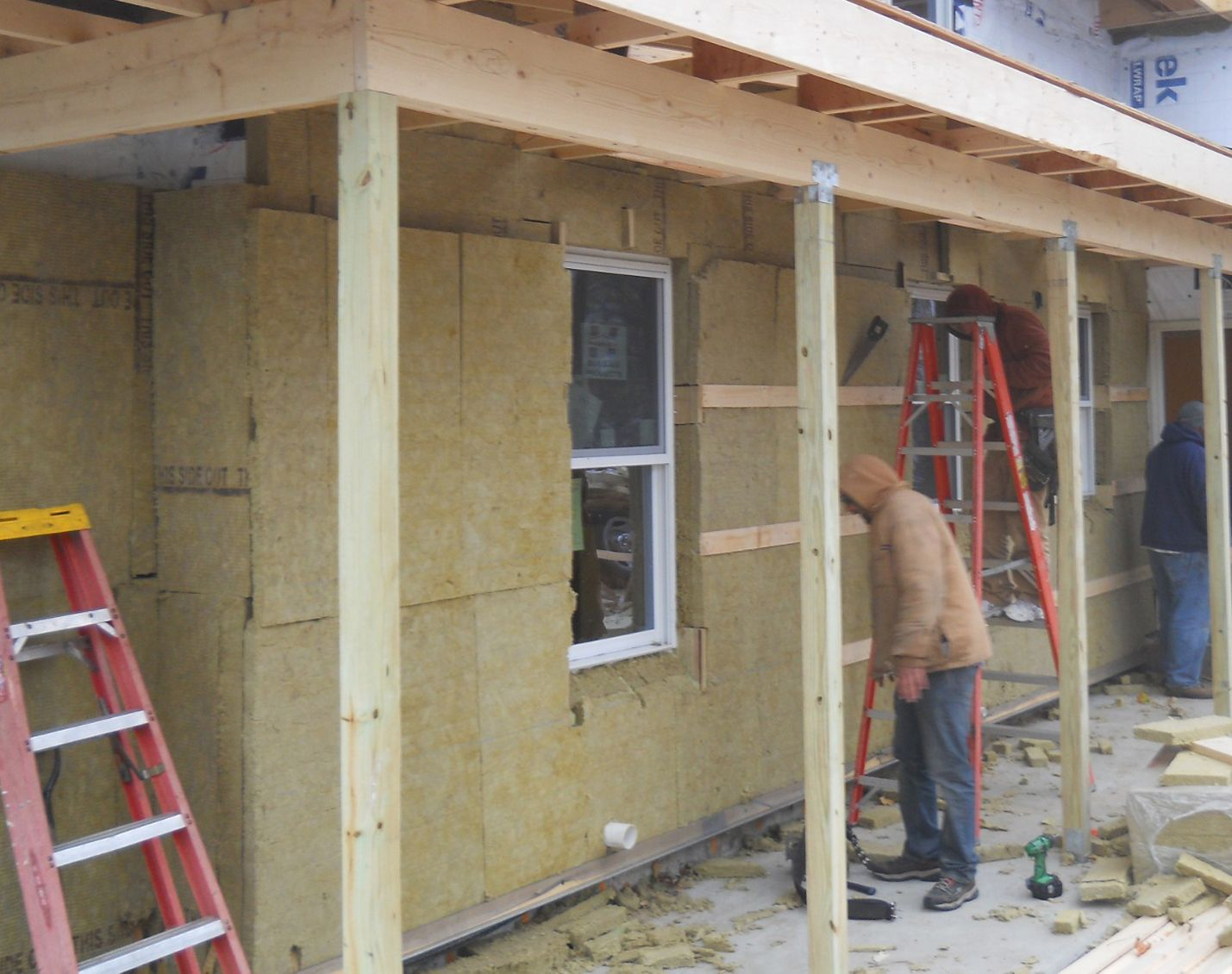 The walls were insulated on the exterior with two layers for Wool house insulation