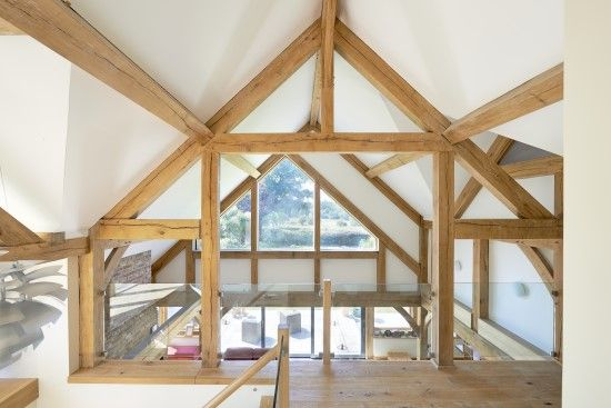 The Vaulted Ceiling Runs All Over The First Floor With Triangular Windows On Both Ends Open Living Oak Framed Buildings Timber Frame Building Oak Frame House