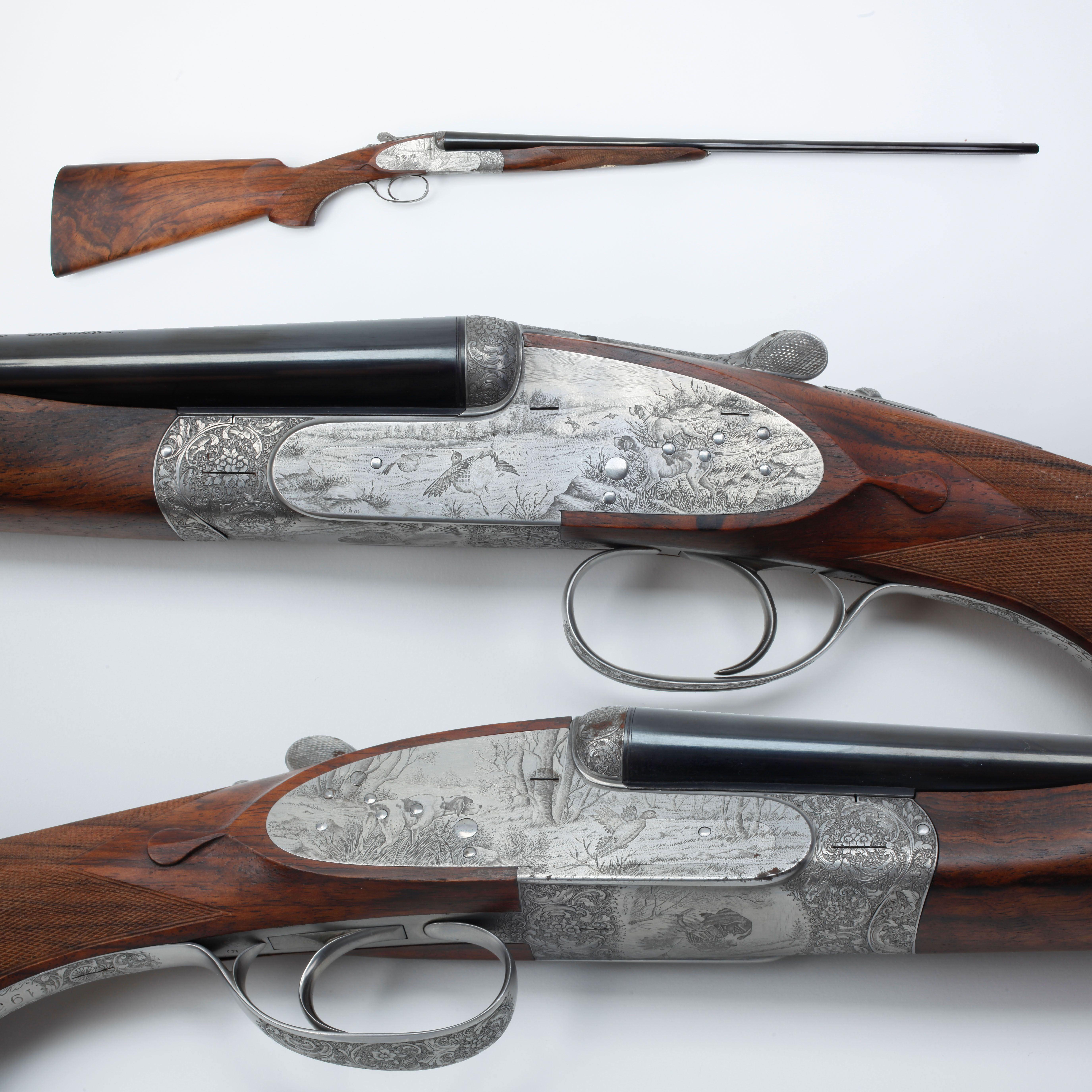 Bulino Engraved Side-By-Side Shotgun - This .410 ga was made by FAMARS (Fabbrica Armi d'Abbiatico e Salvinelli), an Italian gun manufacturer known for its craftsmanship & fine engraving. A single FAMARS requires hundreds, sometimes thousands, of man-hours to complete. The firm makes no more than 110 a year, all of which are specially commissioned. The GOTD also features one of the most time consuming engraving processes, bulino engraving, by artist Angelo Galeazzi with a pheasant hunting…