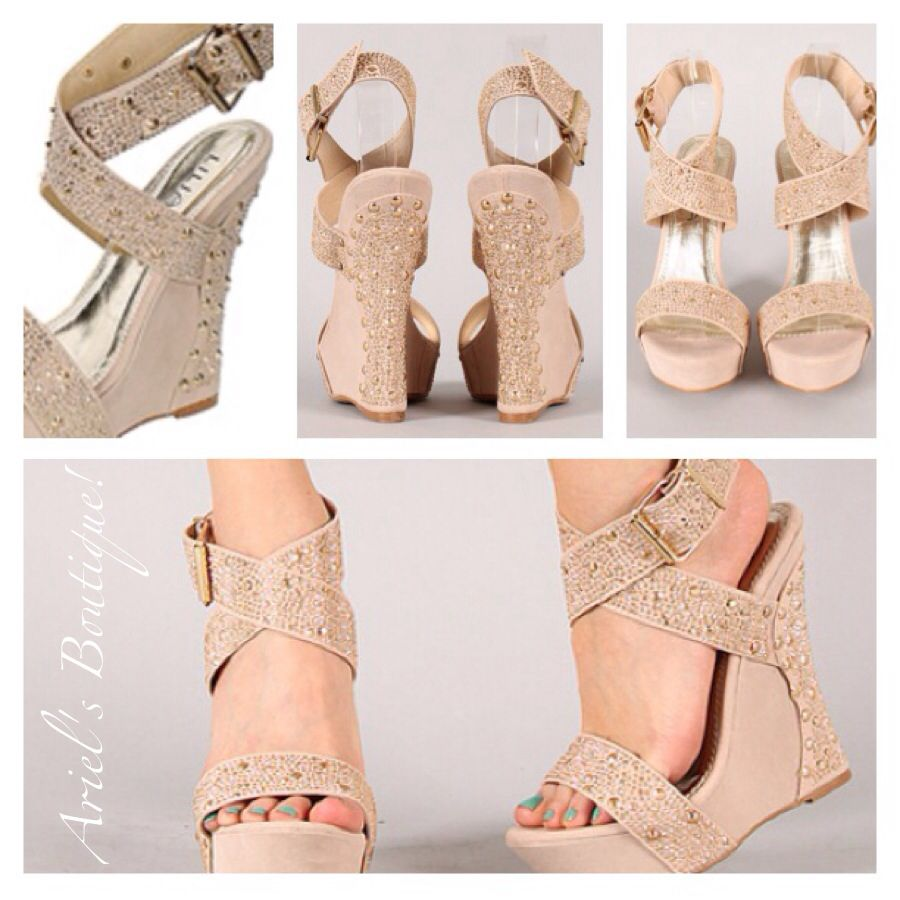 Very stylish jeweled ankle strapped ivory wedge.  Sizes 6-10 available  $36.00
