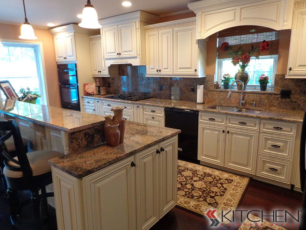 Traditional kitchen with staggered height kitchen counter ...