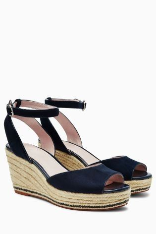 9bb9b462425b Heighten your getaway with these navy wedges - perfect for dressing up your  favourite summer dress.
