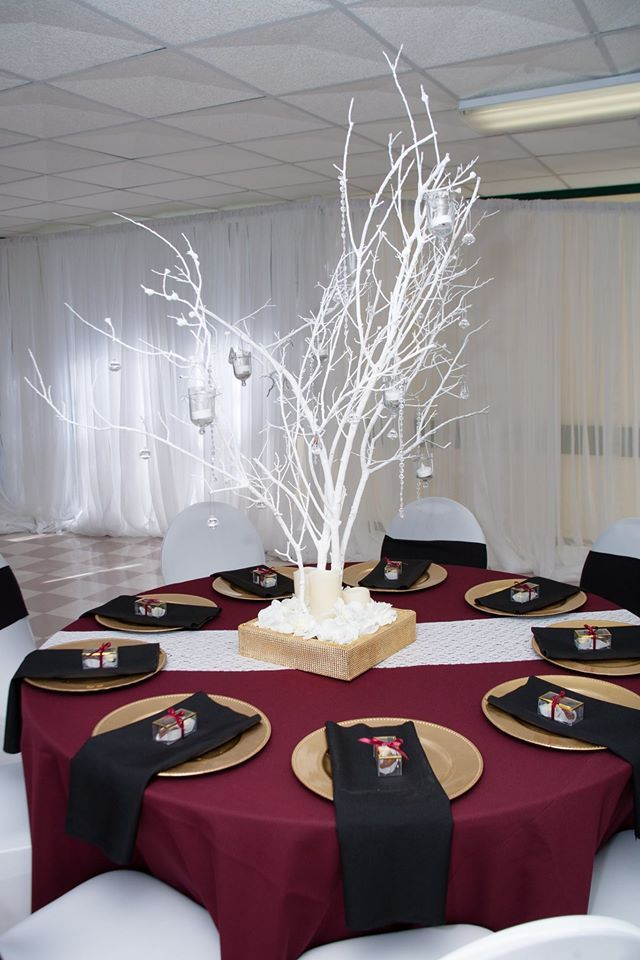 Winter Wedding Reception Table With Red Cloth Gold Plates Black Napkins
