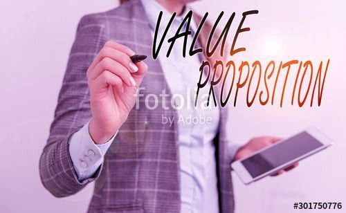 text writing Value Proposition Conceptual photo feature intended to make a company or product attractive Business woman pointing in empty space with pen and mobile phone...