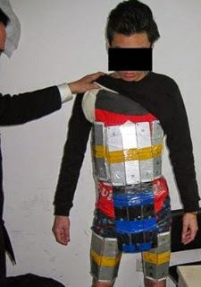 #Funny :Customs Officials Arrested A Man Wearing Suit Made Of #iPhones