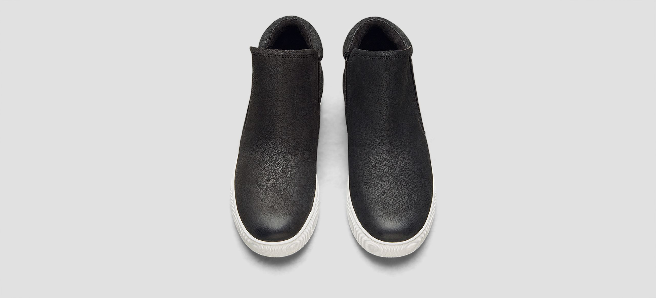 """Slip-on sneaker    Elasticized insets    Round toe    Padding at collar    Nubuck upper    Microfiber lining    Rubber sole    Concealed 1"""" wedge    Imported"""
