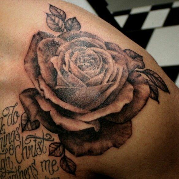 Realistic black and grey rose shoulder tattoo. Brittany Smith skinny boy tattoo Post Falls Idaho