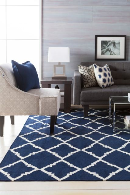 Navy And Gray Is Such A Chic Color Combo When Working In A Darker Palette It S Important To Mix In So Rugs In Living Room Navy Living Rooms Living Room Grey