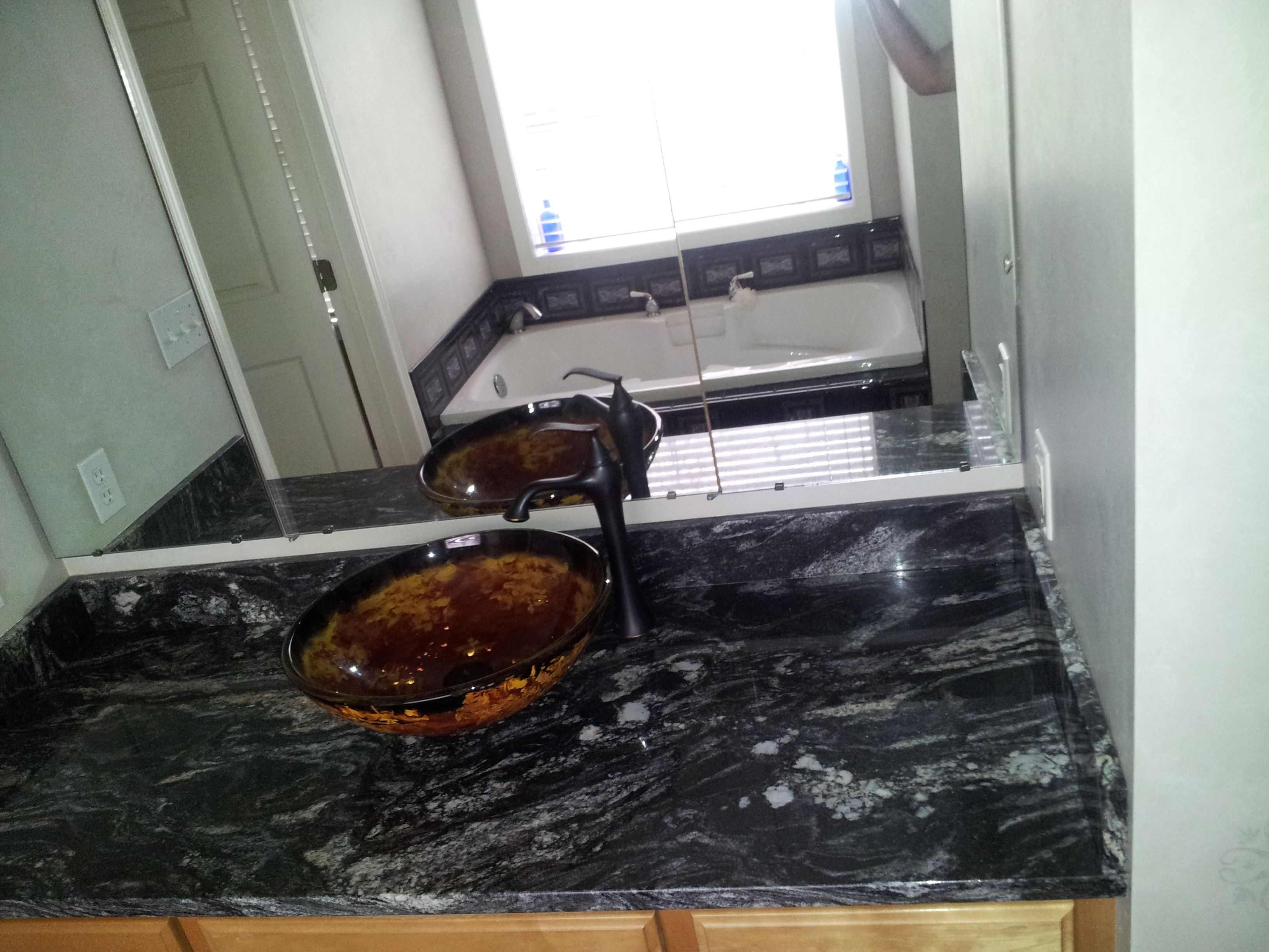 titanium granite countertop for our masterbath with black onyx vessel sink and kraus faucet