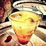 Whiskey Sunrise ~1.5 oz Moonshine Corn Whiskey ~3 oz orange juice ~.5 oz grenadine ~1 cherry Drizzle grenadine into the bottom of an ice-filled glass. Mix Moonshine and orange juice in a shaker. Slowly pour over the grenadine and ice. Garnish with a cherry. Credits: Joe Fenten – Dark Corner Distillery