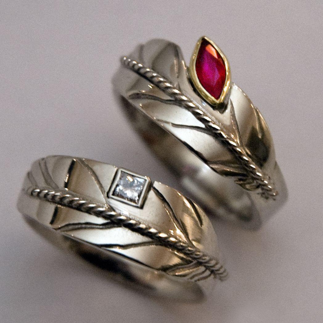 Set of wedding rings by ZhaawanArt symbolizing spirit flight of two