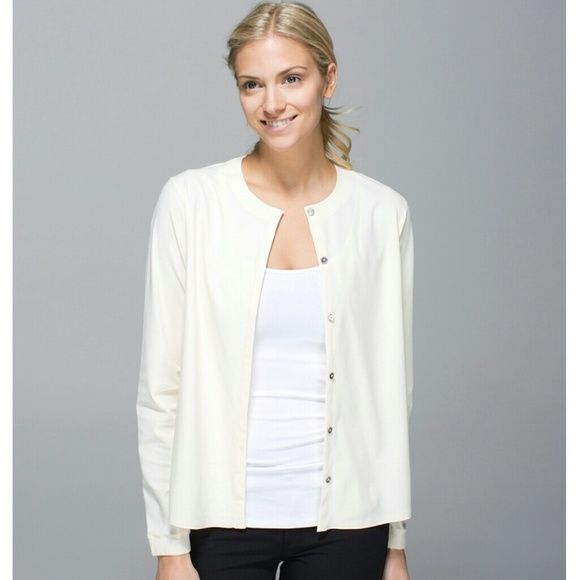 Lululemon Cream (Ghost) Solo Blouse NWOT  Rare and out of stock online!  This versatile blouse can be worn open as a light outer layer, or buttoned up as a blouse. It is a size 4, which fits like an XS.  fabric + features  lightweight fabric is sweat-wicking and four-way stretch to move with you added LYCRA fibres help this blouse keep its shape over time designed not to shrink for hassle-free laundry imported  fit + function  designed for: to-and-from, travel fabric(s): swim, LYCRA fit…