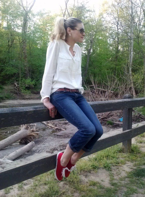 Cuffed jeans, red sneakers