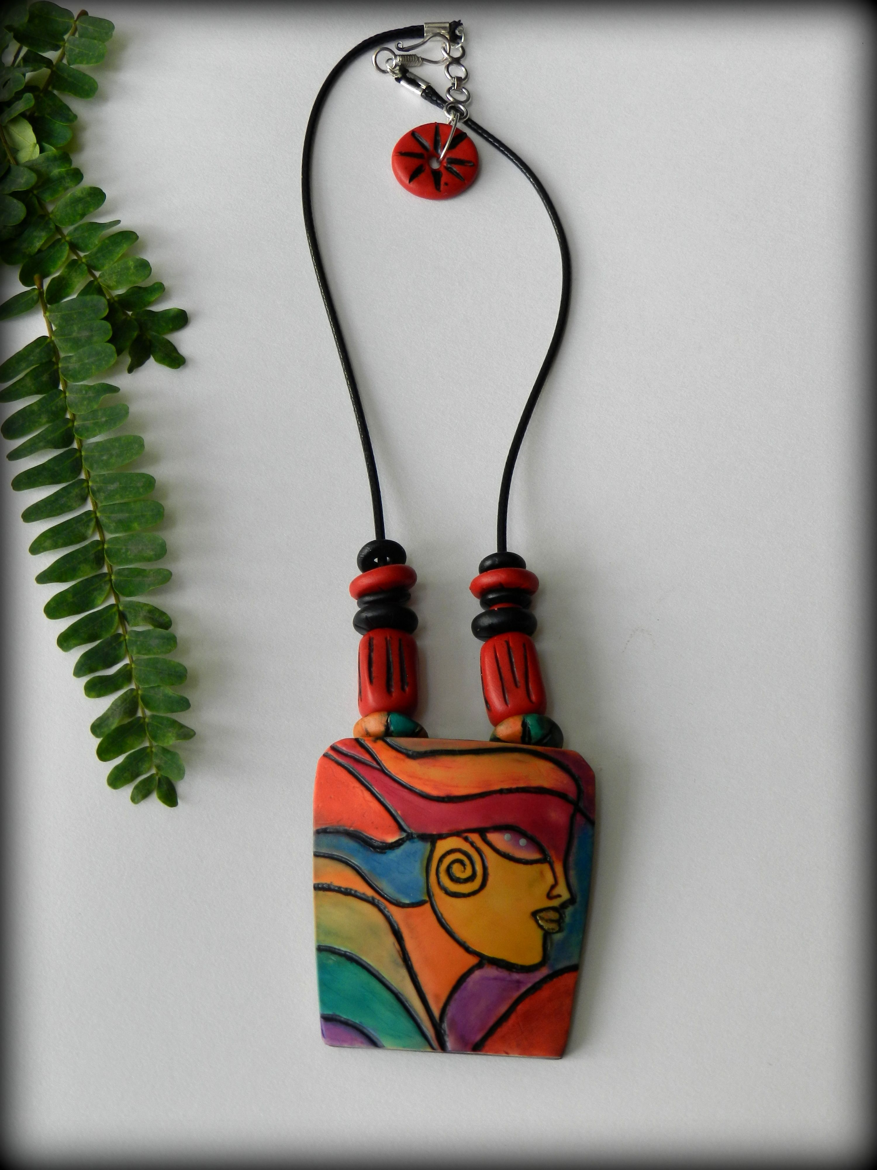 Purely handmade, polymer clay and alcohol inks jewelry.