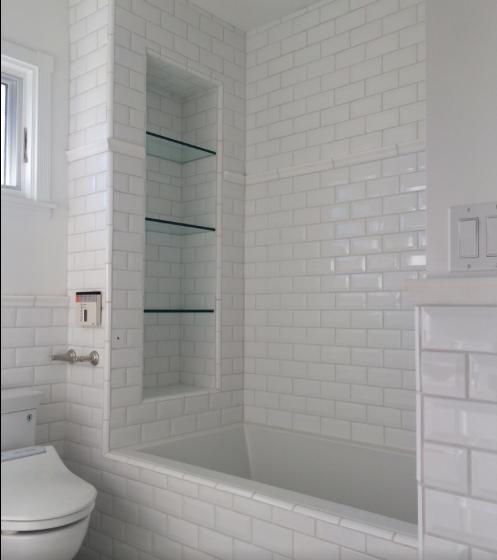 Tile shower shelves at end of bathtub. Large shelves ...