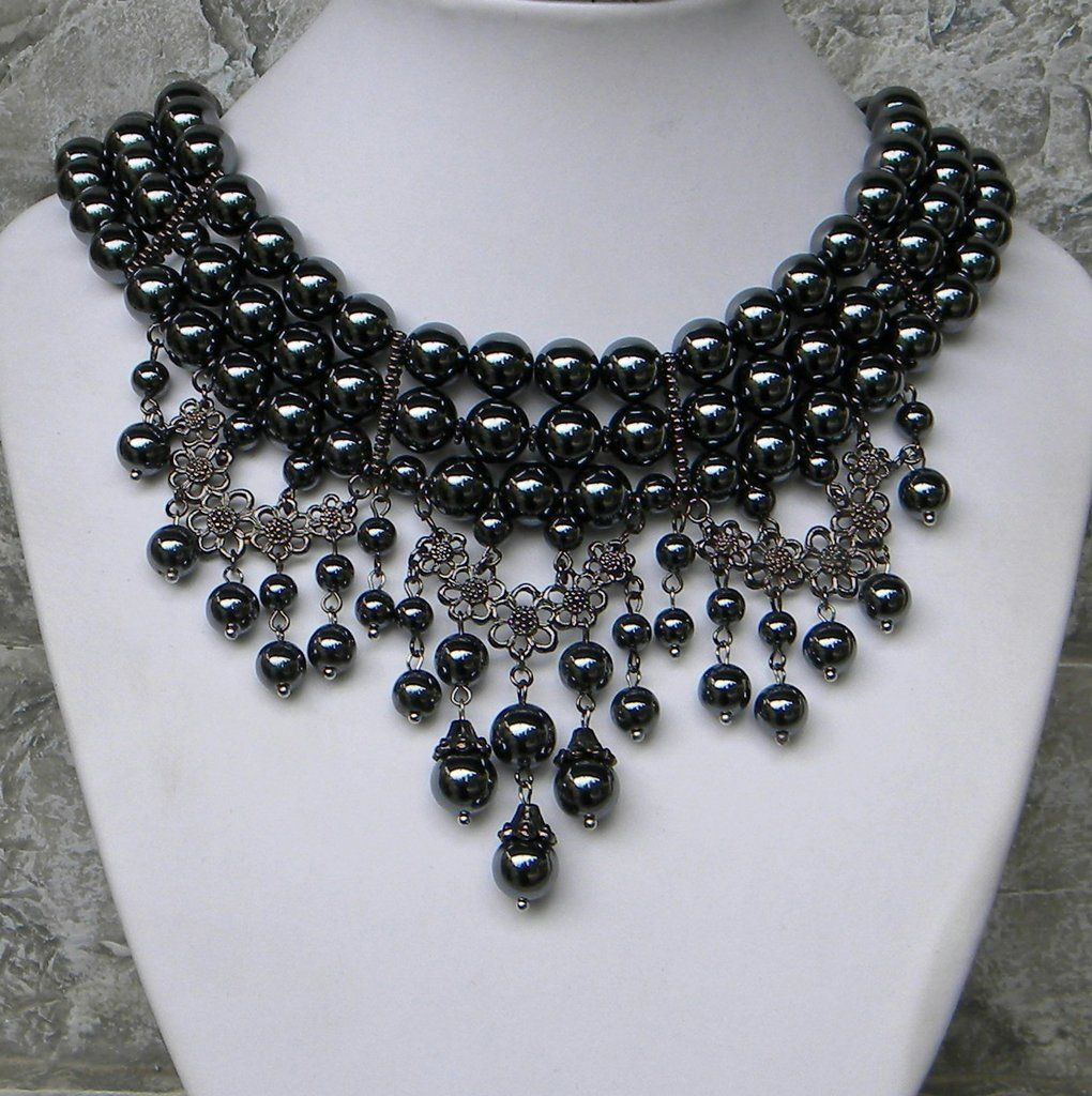 7234113f7 A very bold and heavy choker necklace, dark hematite gray and gunmetal make  a cascading statement and fill out the neck line beautifully.