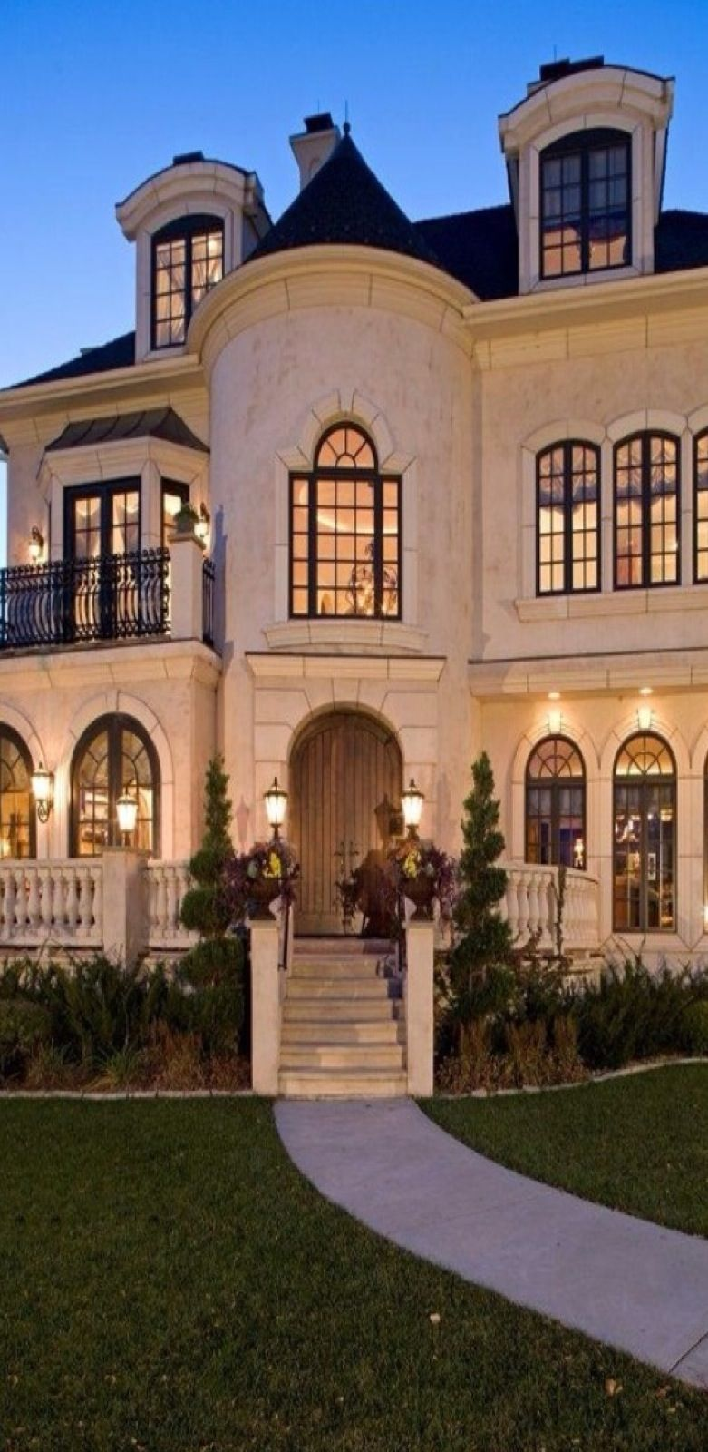 Amazing Home With Turret. Cream Colored Exterior With Dark Roofing.    Luxury Home Decor