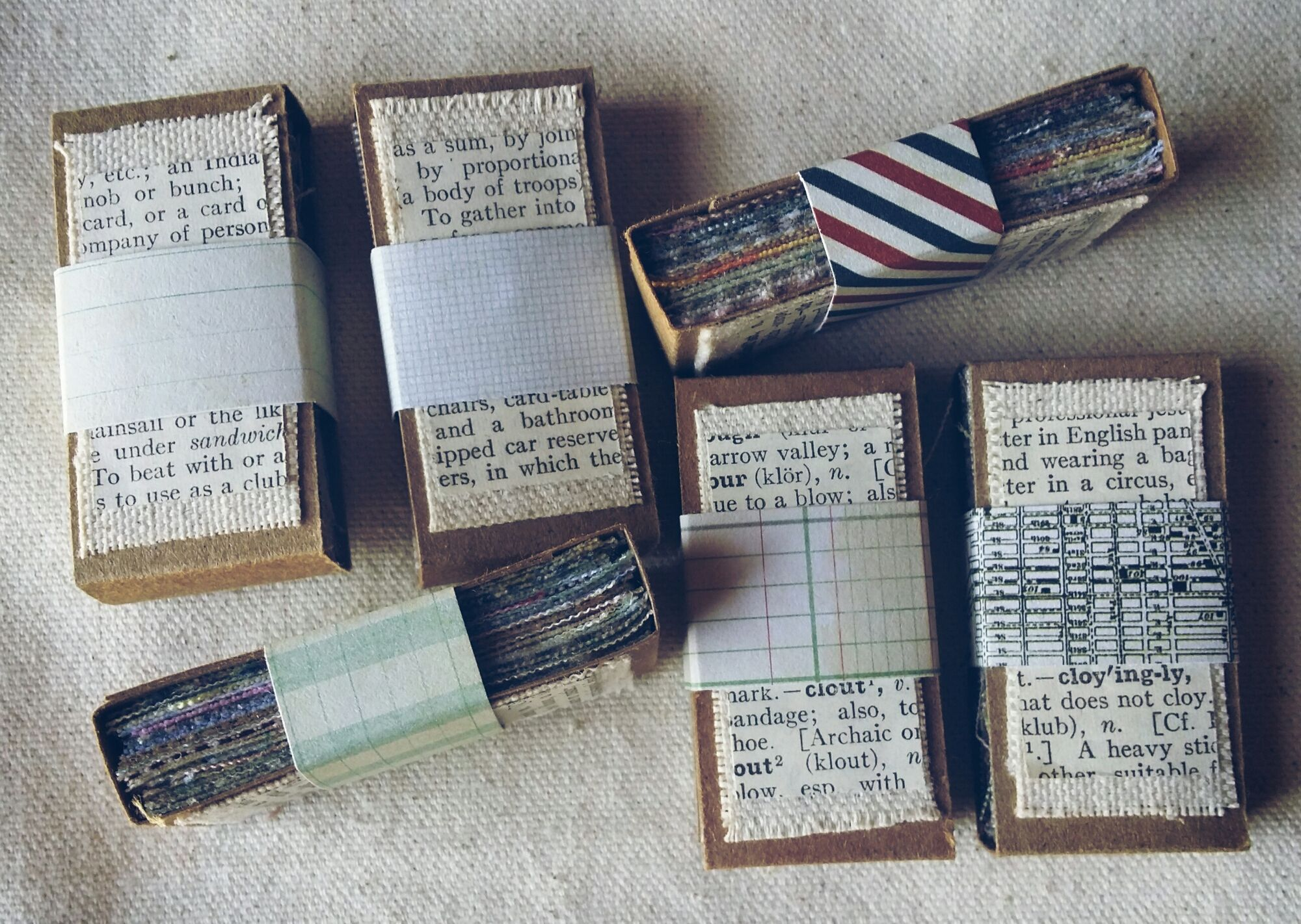1 inch by 2 inch fabric sample packs to be included in ATC Swaps and as Snail Mail treats.  I wonder if matchboxes would work...