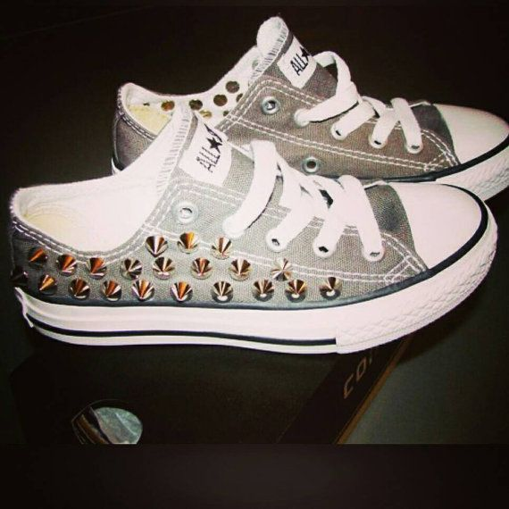 Check out this item in my Etsy shop https://www.etsy.com/listing/214373877/custom-studded-converse-all-star