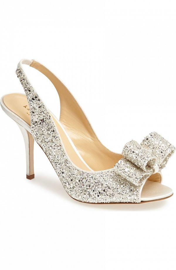 Flecks of glitter add party-ready shine to a chic slingback pump trimmed in lustrous satin.
