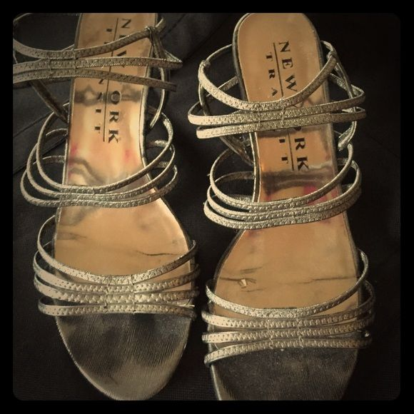 Super Cute Strappy Silver Dress Sandal About a 2 1/2 inch heel. very comfortable. The sandal is an 8 1/2 but I am an 8 and wear it comfortably. the color is more like a gun-metal gray/silver. Very pretty! A couple of nicks on the heel but in great shape! New York Transit Shoes Sandals