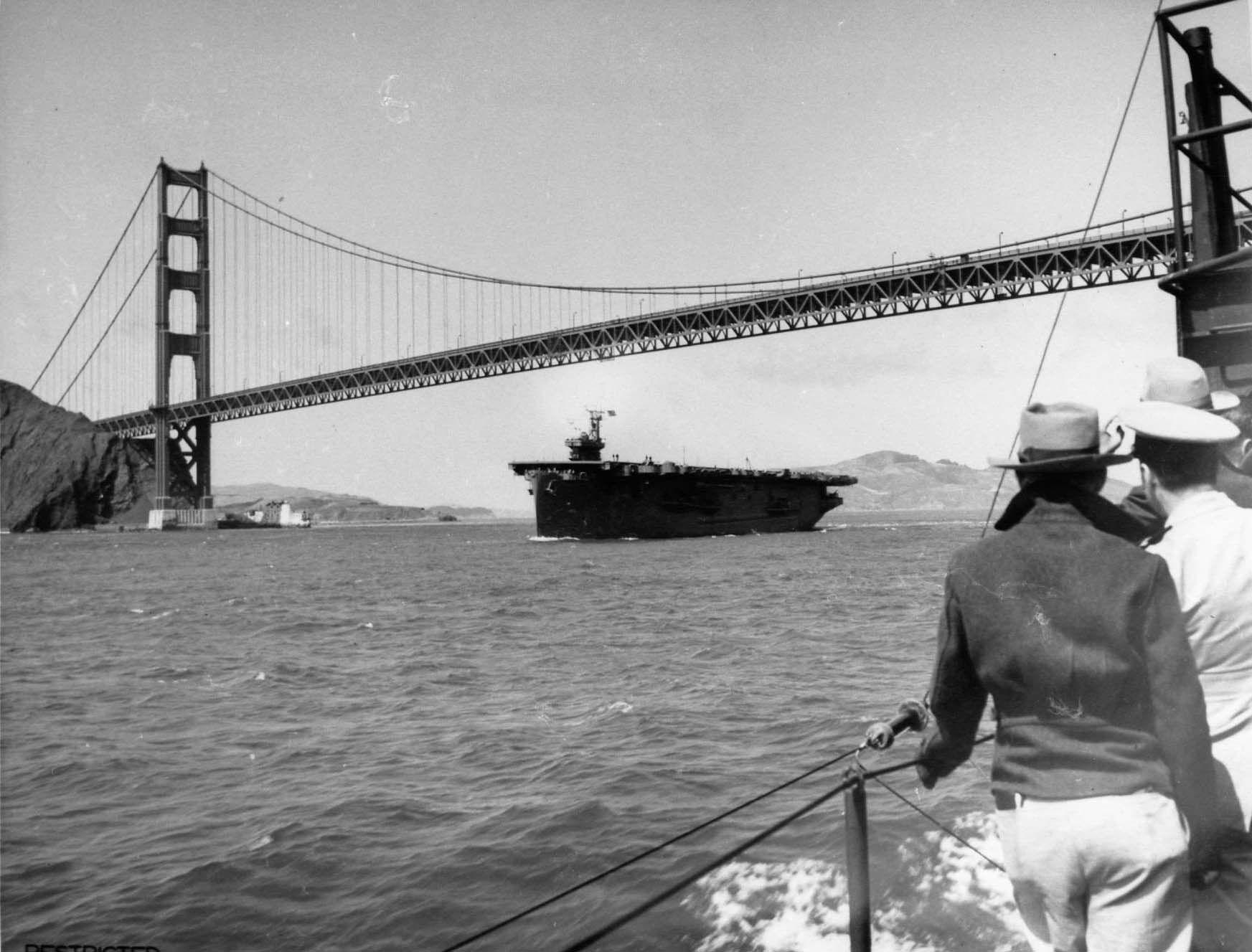 USS Copahee passing under the Golden Gate Bridge, San Francisco Bay, California, United States, 15 Jul 1943