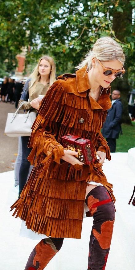 Sofie Valkiers in a Burberry Prorsum fringe suede coat and boots with a Louis Vuitton bag