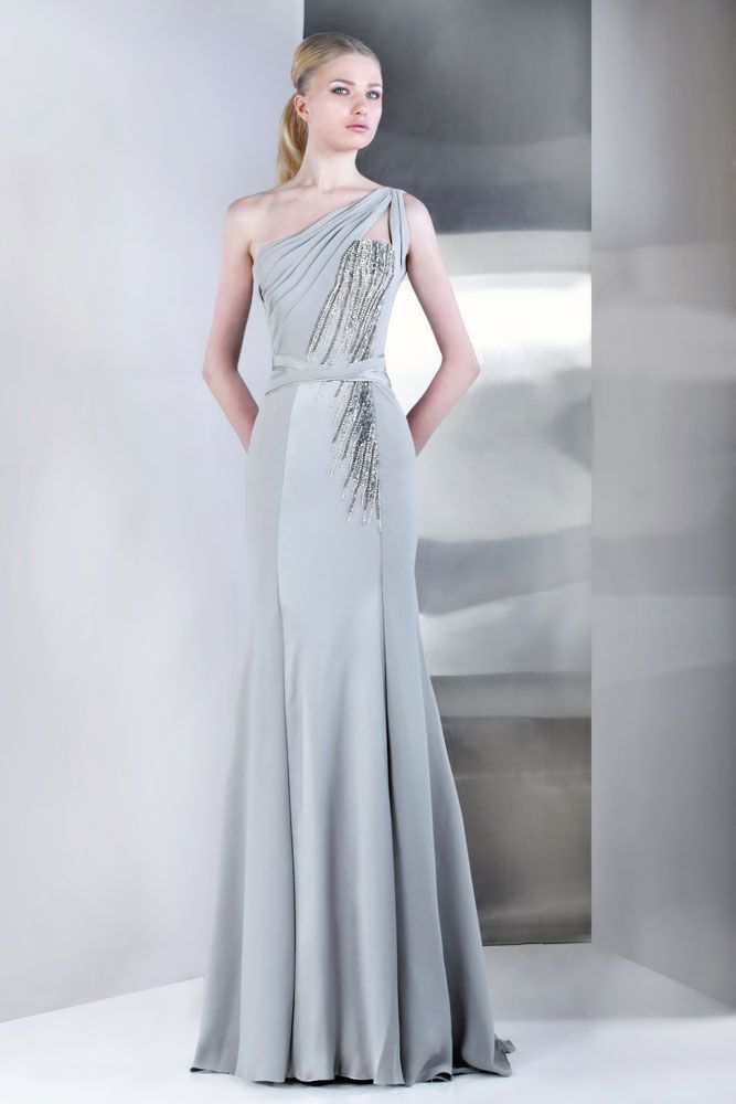 49607c15262994 TONY WARD - One shoulder evening dress in light grey Silk Moroccan Crepe  with cascades of stones on one side.