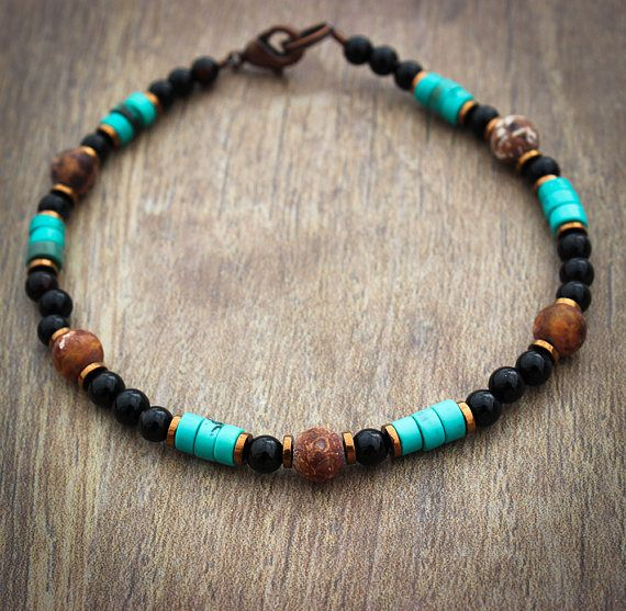 This mens turquoise bracelet features black agate, hematite, turquoise, ancient agate, and copper. The bracelet measures approximately 7.75 inches in length and closes with an antique copper lobster claw clasp. Length can be adjusted upon request. Finding Your Perfect Bracelet Size: While making a fist, measure the size of your wrist with a tailors tape or piece of string. Add a quarter of an inch to this measurement if youd like a little extra room for extra comfort. This item was made…