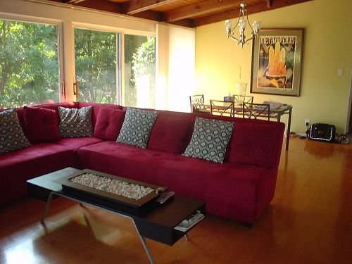 Red couch with yellow walls with a cedar ceiling for for Red and yellow living room ideas