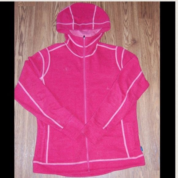 Red KUHL zip up hoodie. Red KUHL zip up hoodie.  This unique hoodie sports light pink contrasting stitching and long torso and sleeves allow for great coverage.  It has two deep pockets and a metal zipper.  Size L.  From a smoke-free home. Kuhl Tops Sweatshirts & Hoodies