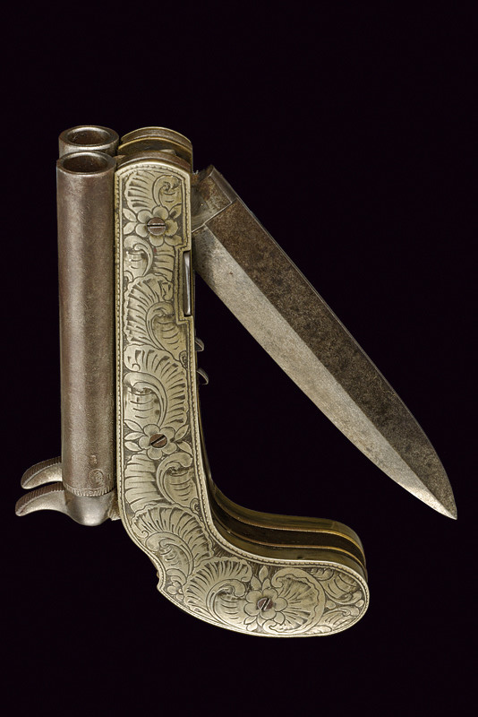 A Very Rare Double Barrelled Percussion Pistol With Knife