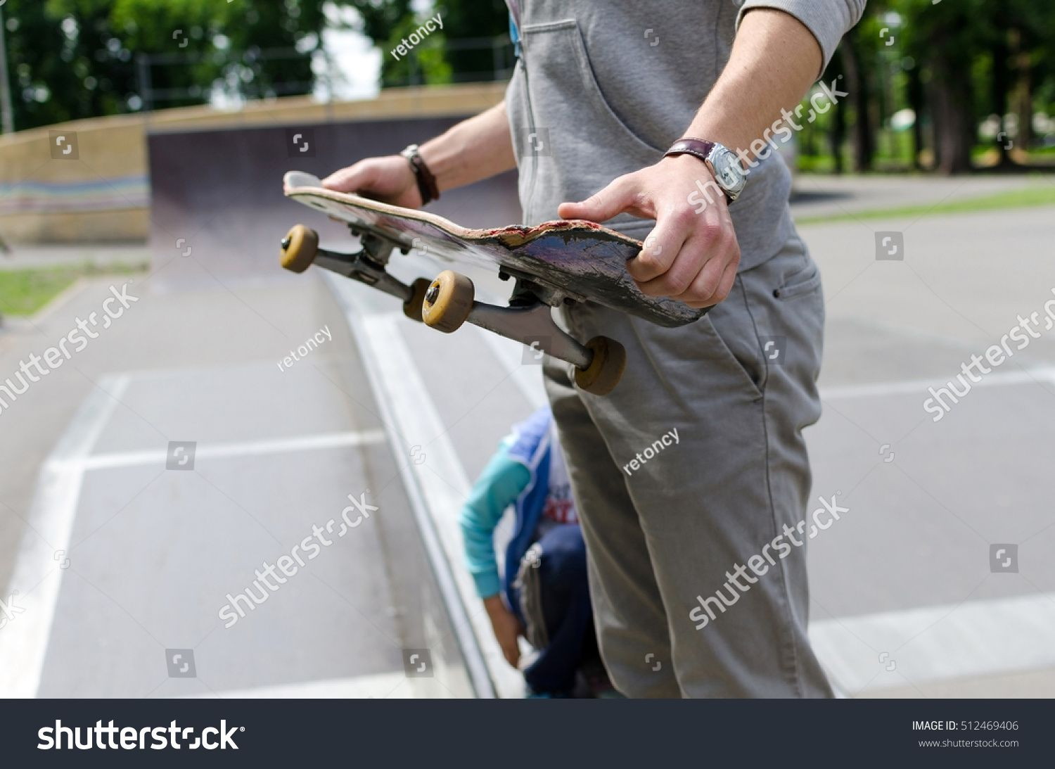 Young man with the skateboard in the park #Ad , #AFF, #man#Young#park#skateboard