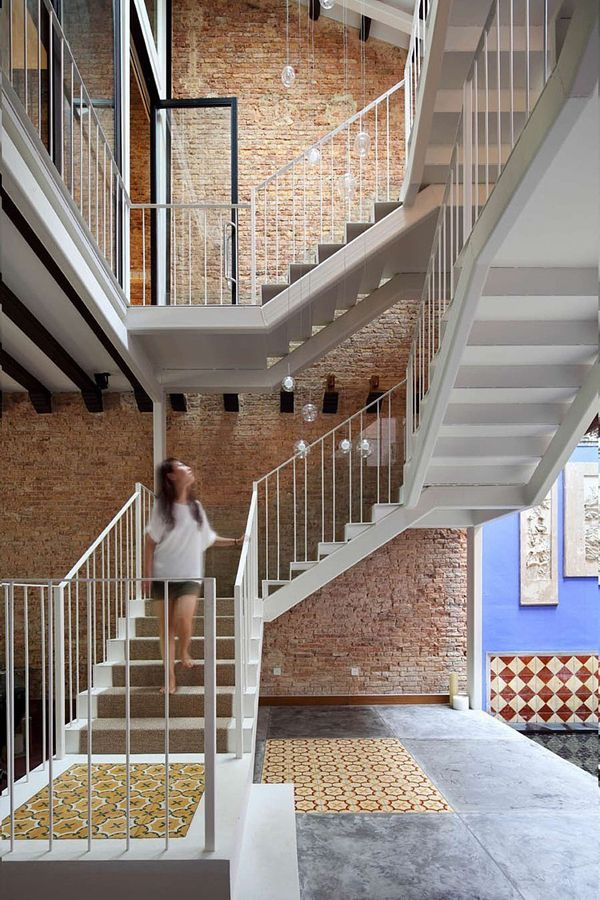 Redesign of a charming peranakan shophouse in singapore exposed brick interior staircase