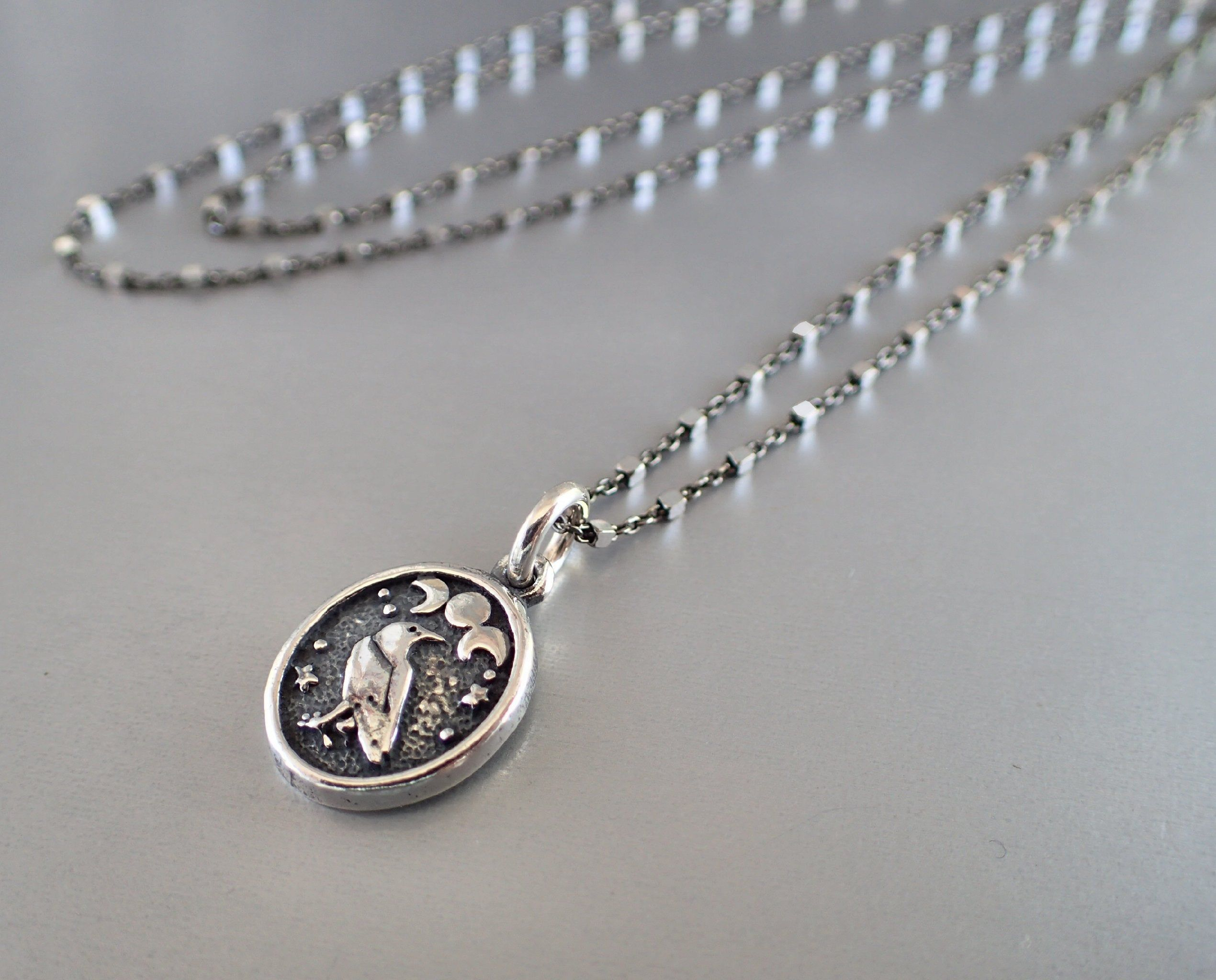 Tiny Moon Phases Necklace in Sterling Silver