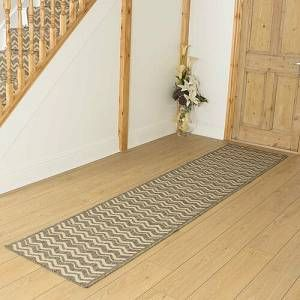 Mercury Row This runner is a flatweave which is more commonly known as a basketweave. Traditionally, flatweave runners are made using natural fibre such as sisal or wool. However, this runner is made using a man-made fibre that is a fraction of the price of a naturally made runner. The pile of this hall
